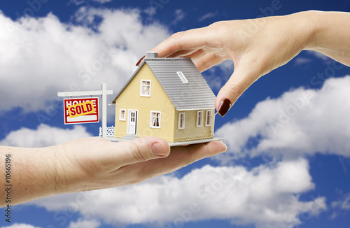Reaching For A Home with Sold Real Estate Sign