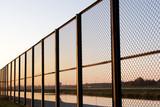 fence on sundown poster