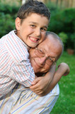 Happy grandfather and grandson poster