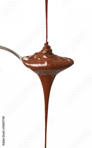 Melted chocolate flowing on a spoon