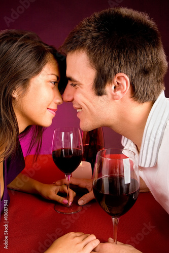 Couple Getting Closer While Having Wine