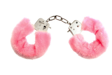 Pink soft handcuffs isolated on white