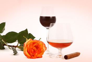 cognac wine and rose isolated on a white background