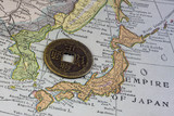 Japan on vintage map and old coin poster