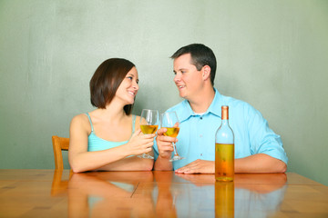 Male And Female Young Caucasian Drink Wine