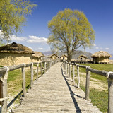 Old wooden narrow alley near an old lake settlement poster