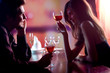 Young couple sharing a glass of red wine in restaurant - 10715509