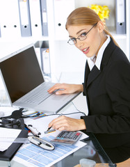 Beautiful business woman working in office, smiling