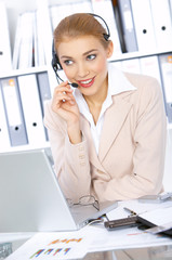 Business woman working in office, wearing headset