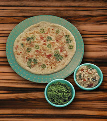 Onion uttapam Stuffed with chilli and coconut chutney, India.