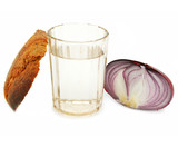 Crust of bread, glass of alcohol and onion