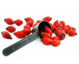 Rose hips and measuring spoon