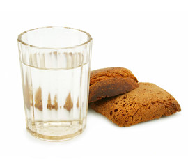 Crust of bread and glass of alcohol