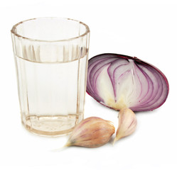 Glass of alcohol, garlic and onion