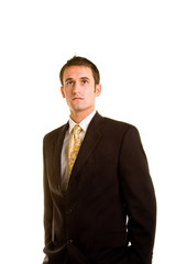 Young Man in Business Suit Hands in Pockets Looking Up