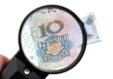 Chinese yuan banknote through a magnifier