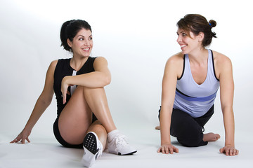 Two women stretching their legs