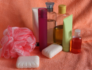Toiletries on pink towel