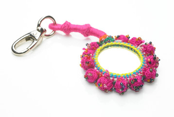 Pink key chain in white background