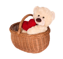 teddybear with red heart in wicker basket