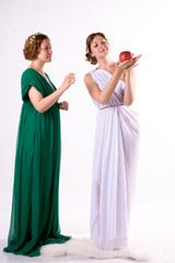 Two ladies and one apple
