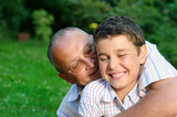 Grandfather and grandson having fun poster