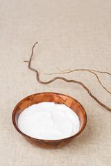 Shea butter. Skin cream in wooden bowl