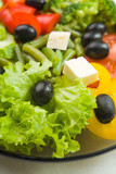 Closeup photo of plate with vegetarian salad, outdoors poster