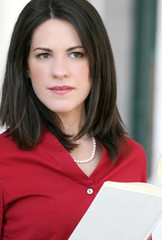 Attractive Business Woman with a book