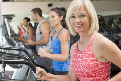 Woman Running On Treadmill At Gym