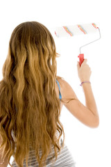 back pose of girl with roller brush
