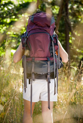 Woman with backpack hiking