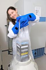 Scientist freezing tissue culture in liquid nitrogen
