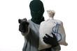 Изображение человек в маске с пистолетом и сумка stock photography.