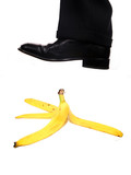 business shoe steping a banana