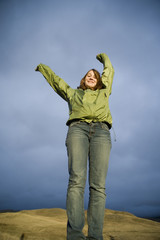 Happy teen girl with raised arms