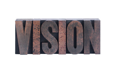 the word 'vision' in old ink-stained wood type