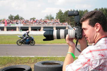 Photographer on motorcycle race