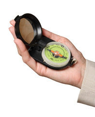 Tourist compass in a female hand