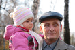 Grandfather with  granddaughter on hands outdoor