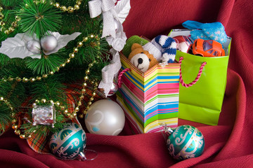 Christmas decorated fur-tree and  packages with gift