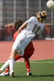 High school soccer players vying for a header poster