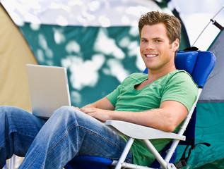 Camper using laptop