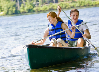 Couple rowing boat