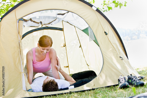 Couple laying in tent