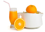 Juice extractor with a glass of orange juice isolated on white