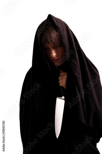Girl in the black sheet with the knife, isolated on white