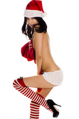 Sexy beautiful woman wearing Santa helper costume