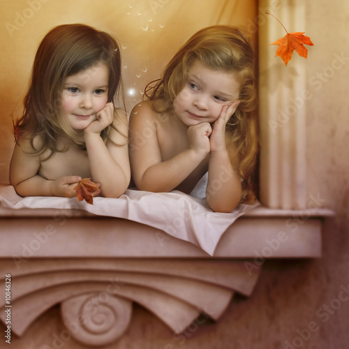 Two angels on the window