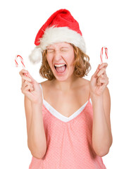 Girl in a santa clause cap with  red and white candy canes
